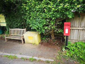 post box top village after